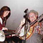 "Cathy playing with Louis Marshall ""Grandpa"" Jones"